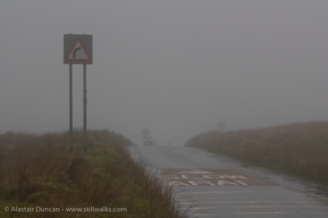 mountain road in mist and rain